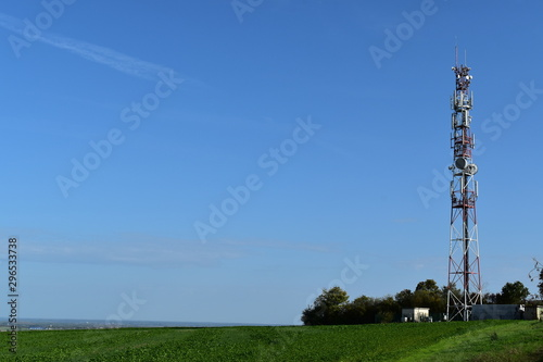 Fotomural Telecommunication tower with radio antennas in a green environment