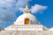 World Peace Stupa In Lumbini, Nepal. World Peace. The Non-english Text Translates To Nanmyouhourrnn, A Buddhist Script Roughly Translating To May Peace Prevail On Earth.