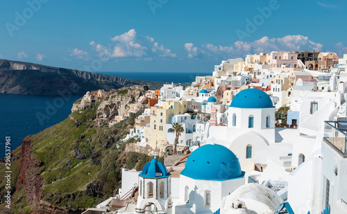 Staande foto Santorini iconic and famous Santorini blue church domes in Oia