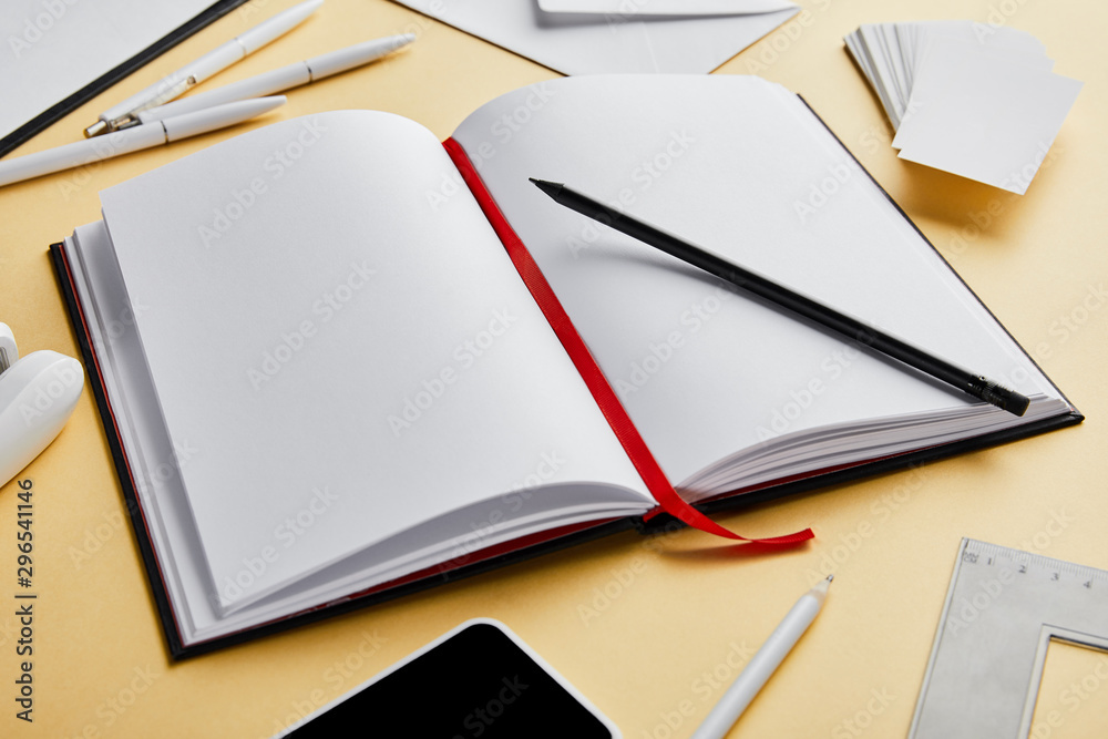 Fototapety, obrazy: envelope, pens, pencil, notebook, business cards, smartphone with copy space