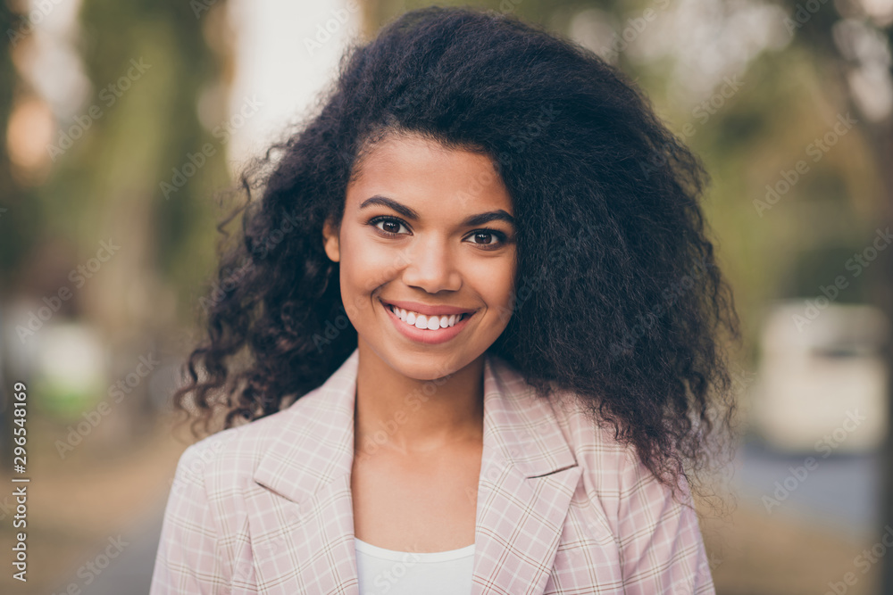 Fototapeta Close up photo of amazing pretty dark skin lady toothy smiling spending adorable free time walking green park outside gold autumn season wearing jacket