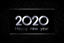 2020 New Year Sign With Shiny Silver Letters And Sand On Black Background.