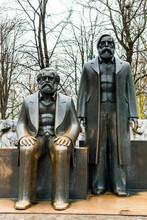 Statue Of Karl Heinrich Marx And Friedrich Von Engels In The  Park In Berlin, Germany.
