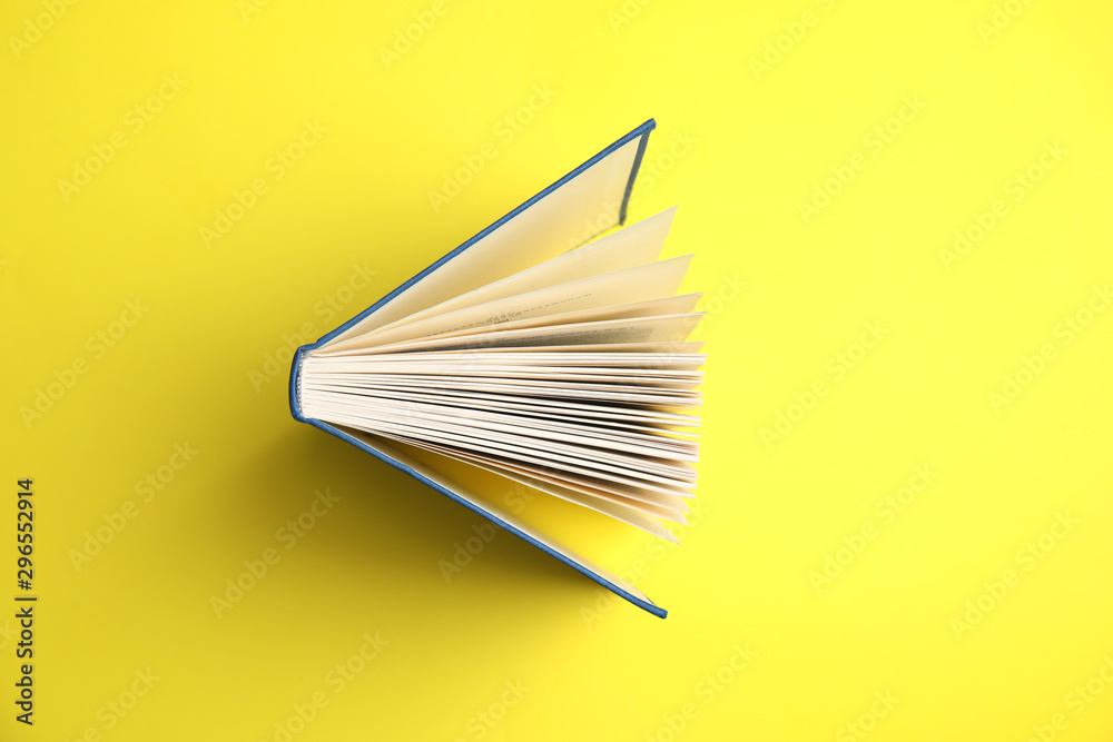 Fototapety, obrazy: Hardcover book on yellow background, top view