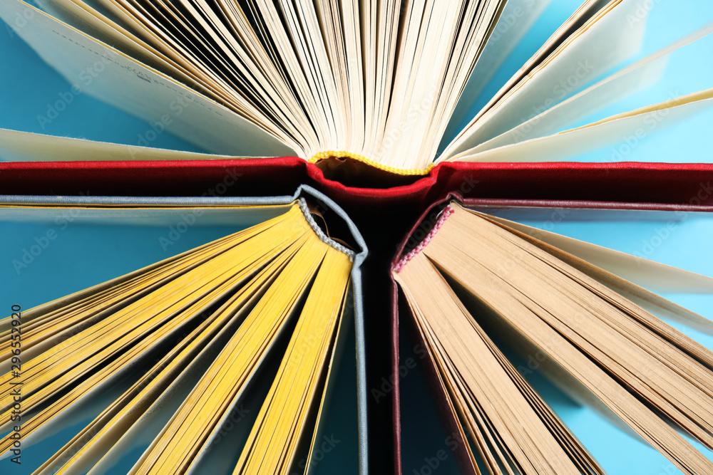 Fototapety, obrazy: Hardcover books on light blue background, flat lay