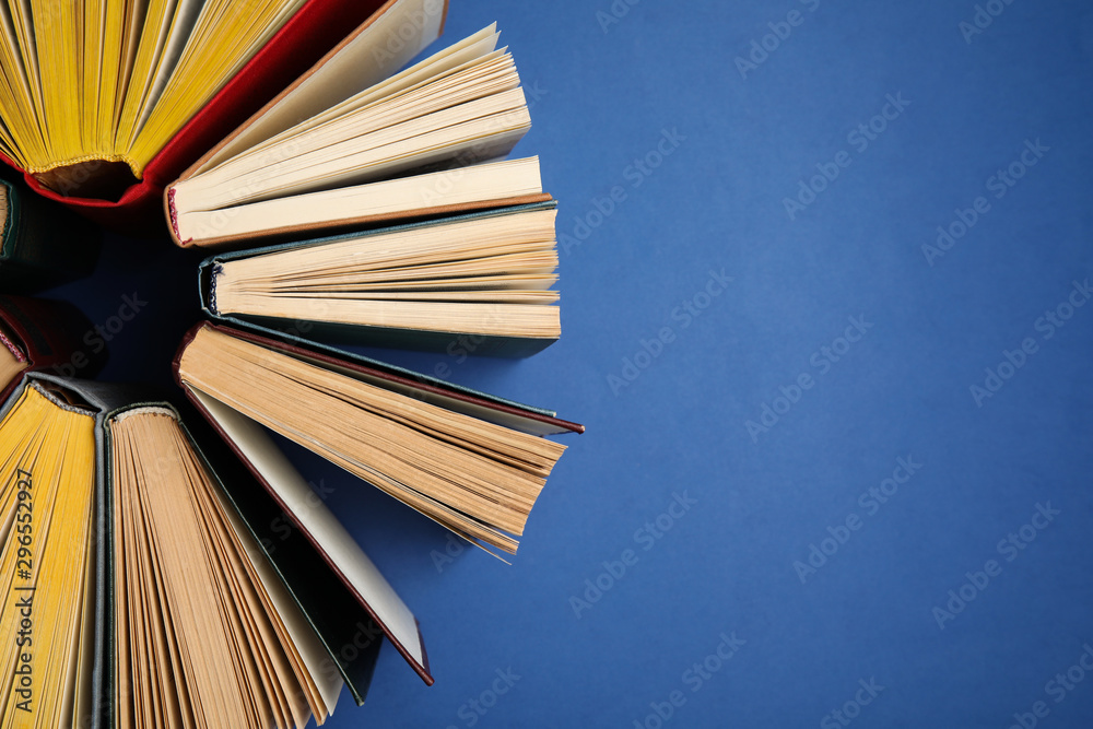 Fototapety, obrazy: Hardcover books on blue background, flat lay. Space for text