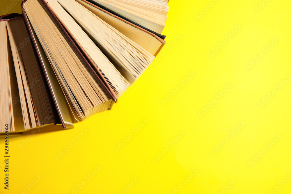 Fototapety, obrazy: Hardcover books on yellow background, flat lay. Space for text