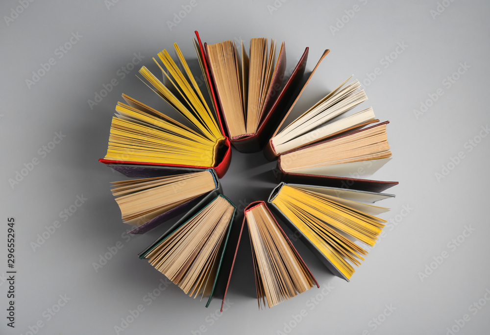 Fototapety, obrazy: Circle made of hardcover books on grey background, flat lay