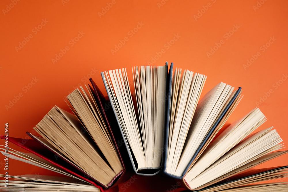 Fototapety, obrazy: Hardcover books on orange background, flat lay