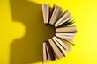 Leinwandbild Motiv Hardcover books on yellow background, flat lay. Space for text