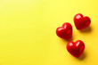 canvas print picture - Red hearts on yellow background, flat lay. Space for text