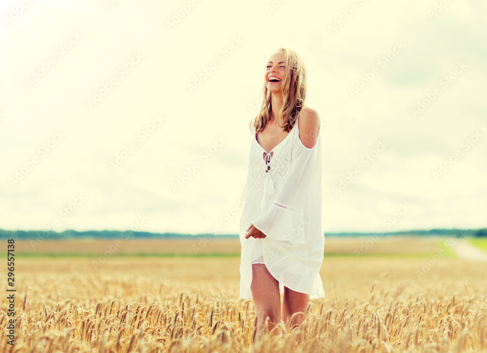 Fototapety, obrazy: country, nature, summer holidays, vacation and people concept - smiling young woman in white dress on cereal field