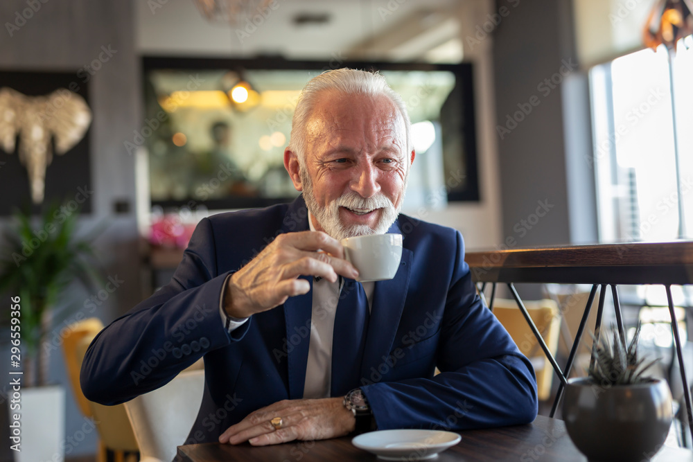 Fototapeta Senior businessman on a coffee break