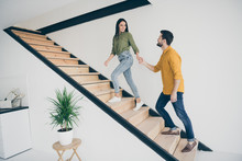 I Will Show You Our Bedroom. Full Length Profile Photo Of Handsome Guy And His Pretty Lady Going Up Stairs In New Modern Flat Indoors Wear Casual Clothes