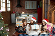 Leinwanddruck Bild - Medium shot mother and children with gifts