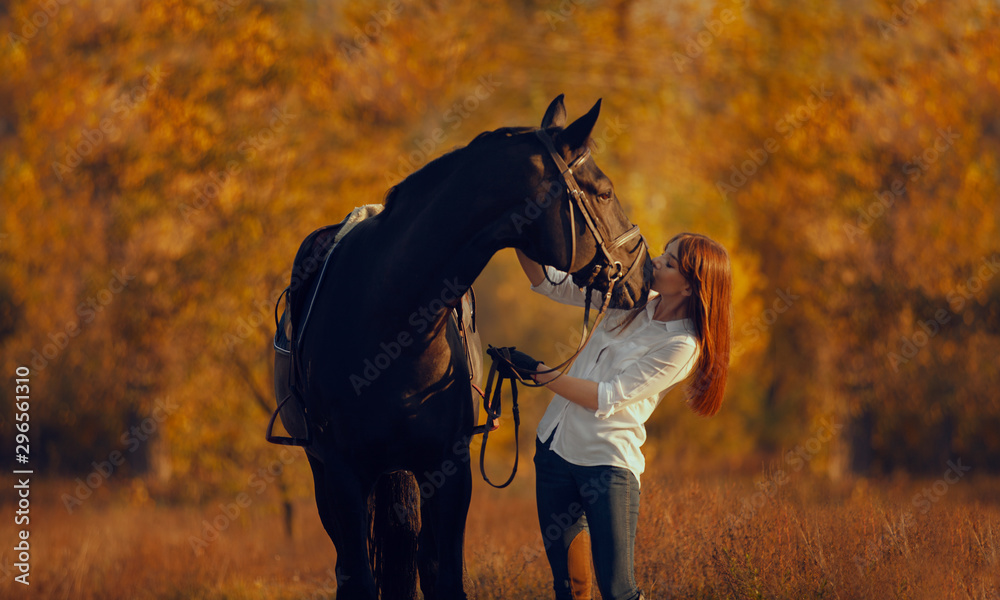 Fototapety, obrazy: Young girl riding a horse.