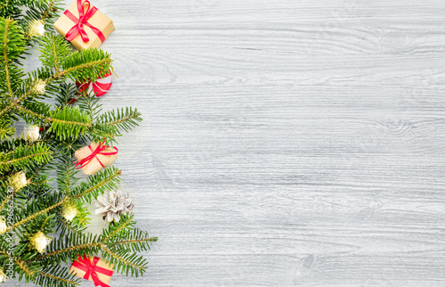 Photo sur Toile Pays d Europe Christmas fir tree on a wooden background