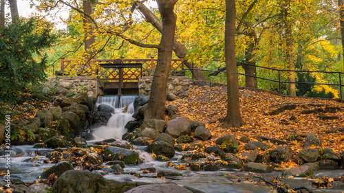 Printed kitchen splashbacks Forest river Picturesque waterfall in the Oliwa Park in autumnal scenery. Gdansk. Poland.