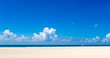 Leinwandbild Motiv Sea view from tropical beach with sunny sky.