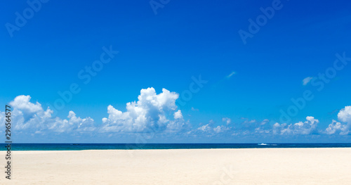 Sea view from tropical beach with sunny sky.