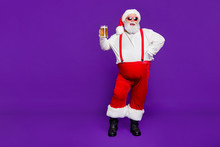 Full Length Body Size View Of Nice Glad Cheerful Cheery Confident Cool Bearded Thick Fat Santa Having Fun Drinking Beer Midnight Fairy Isolated Over Bright Vivid Shine Vibrant Violet Lilac Background