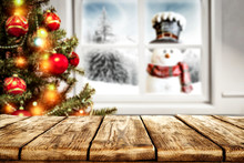 Desk Of Free Space For Your Decoration And Winter Window Background With Snowman