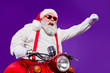 canvas print picture - Photo of santa claus role man rapid riding newyear party by bike excited to see friends using super powers to move fast wear sun specs trousers hat suspenders isolated purple background