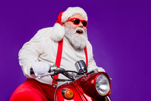 Photo Of Santa Claus Role Man Riding Newyear X-mas Theme Party By Bike Excited To See Friends Wear Sun Spectacles Trousers Hat Suspenders Isolated Purple Background