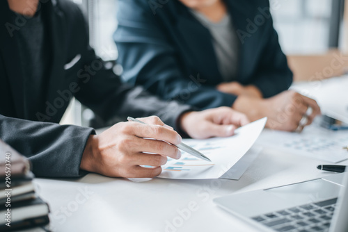 Obraz Business people discussion and summary financial information at meeting. - fototapety do salonu