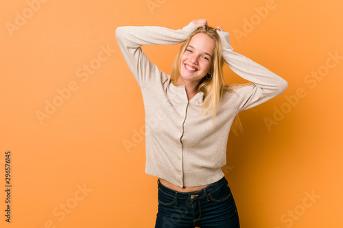Fototapety, obrazy: Cute caucasian teenager posing standing against a orange background