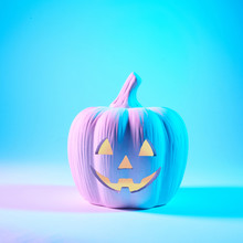 A Jack O Lantern Glowing With Neon Light On Halloween Evening. Pastel Colors