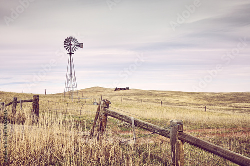 Fotografía American countryside with an old windmill tower, color toning applied, USA
