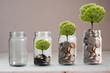 Leinwanddruck Bild Money coins and tree growing in jar. Profit on deposit in bank and dividend for stock investment concept.