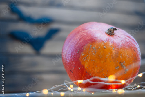 Fototapety, obrazy: pumpkin on wooden table with yellow lights, Halloween background,