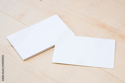 Blank template for branding identity of white business name card for mock up process on wooden table background Fototapet