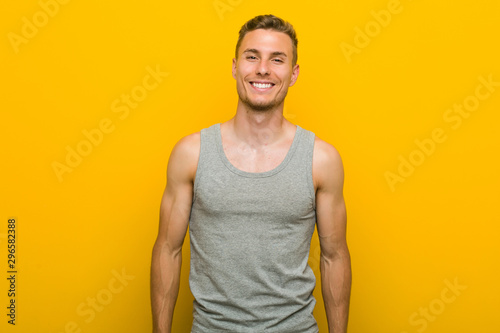 Leinwand Poster  Young caucasian sport man happy, smiling and cheerful.