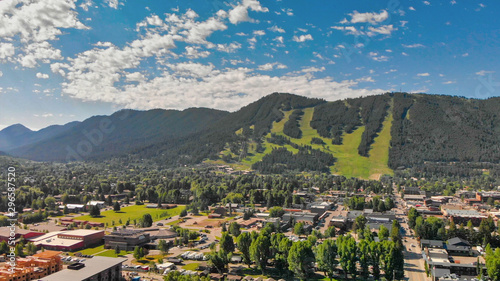 Foto op Canvas Bomen Panoramic aerial view of Jackson Hole homes and beautiful mountains on a summer morning, Wyoming