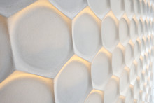 Hexagonal Wall Honeycomb Modern White Wall With Woark Gold Lighting In A Perspective Angle Background