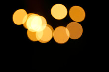 Beautiful Luxury Background. Picture For Christmas. Simple Dark Background With Round Orange Spots In Defocus. Bokeh Effect Bright Colored Circles On A Black Background. Fashionable Texture. Christmas