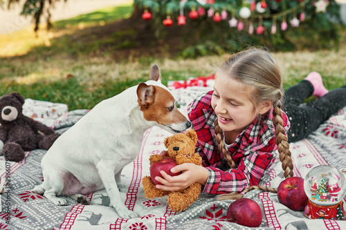 child girl with dog Jack Russell Terrier near the Christmas tree with gifts, Chr Wallpaper Mural