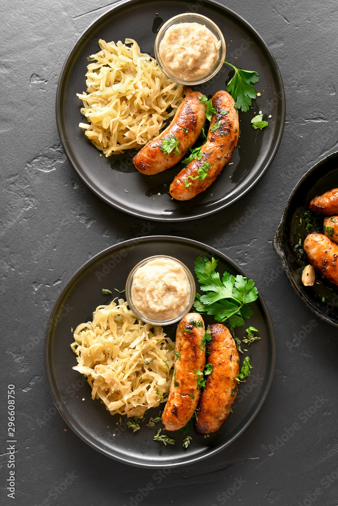 Fototapety, obrazy: Grilled sausages with sauerkraut and horseradish