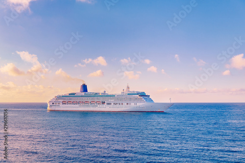Fototapeta Luxury cruise ship sunset in blue sea with clouds obraz