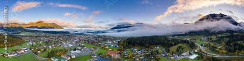 Spoed Foto op Canvas Panoramafoto s dawn panorama of reutte village at fall with clouds and mountains