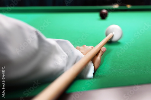 Fotografie, Obraz  Young woman playing billiard indoors, closeup