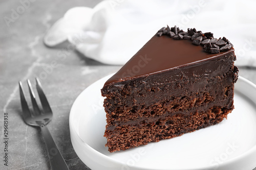 obraz lub plakat Delicious fresh chocolate cake served on grey table, closeup