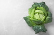 Fresh green savoy cabbage on marble table, top view. Space for text
