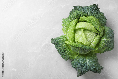 Obraz Fresh green savoy cabbage on marble table, top view. Space for text - fototapety do salonu