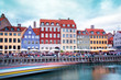 canvas print picture - Breathtaking beautiful scenery with  in the famous Nyhavn with strips from the trail of the sailing boat in Copenhagen, Denmark. Exotic amazing places. Popular tourist atraction.