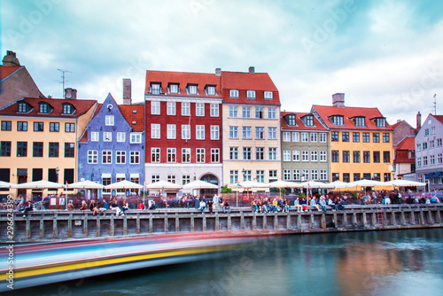 Breathtaking beautiful scenery with  in the famous Nyhavn with strips from the trail of the sailing boat in Copenhagen, Denmark Canvas Print