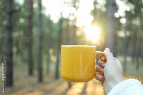 Poster de jardin The Woman hold yellow cup in forest, space for text